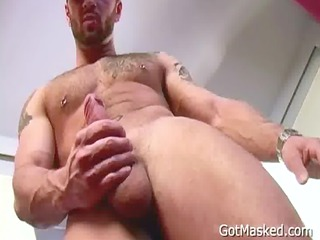 tattooed and pierced man stripping homosexuals