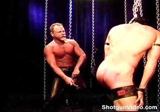 masked bodybuilder restrained, gagged, hooded has