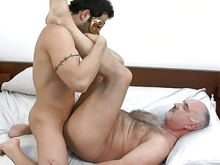 masked and tattooed gay hunk receives rammed hard