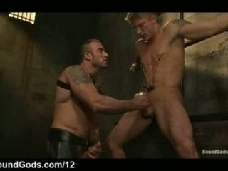 bound homo gets tugjob and throat fucked in