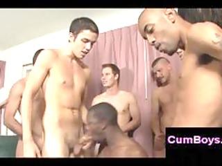 dark homosexual guy sucking multiple ramrods in