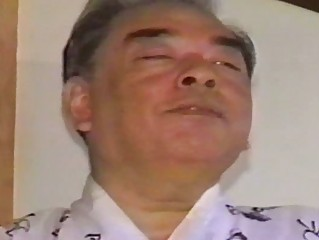older oriental homosexual guy touching himself