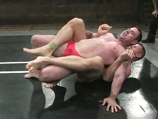beefy homosexual guys wrestling hard and coarse