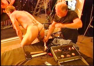 suspended bodybuilder bottom with electro booty